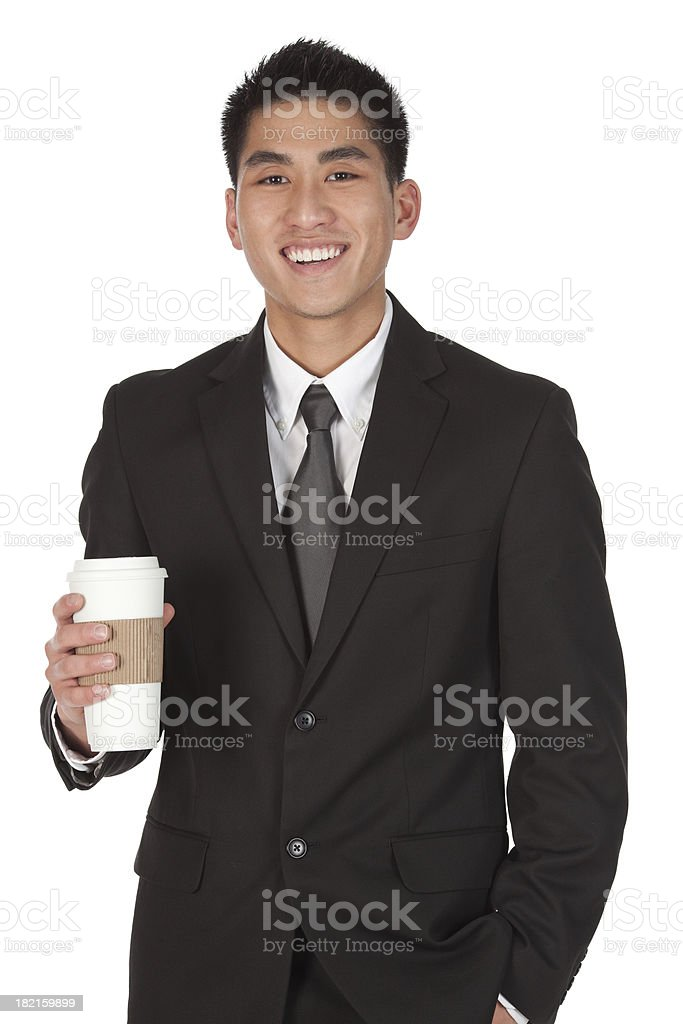 Businessman holding a disposable cup royalty-free stock photo