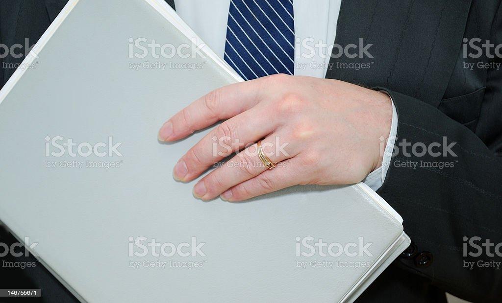 businessman holding a folder royalty-free stock photo