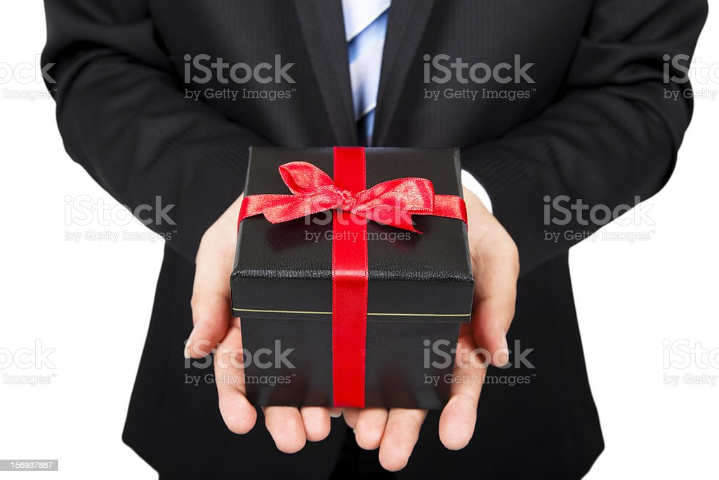 Businessman holding a gift package in hand royalty-free stock photo