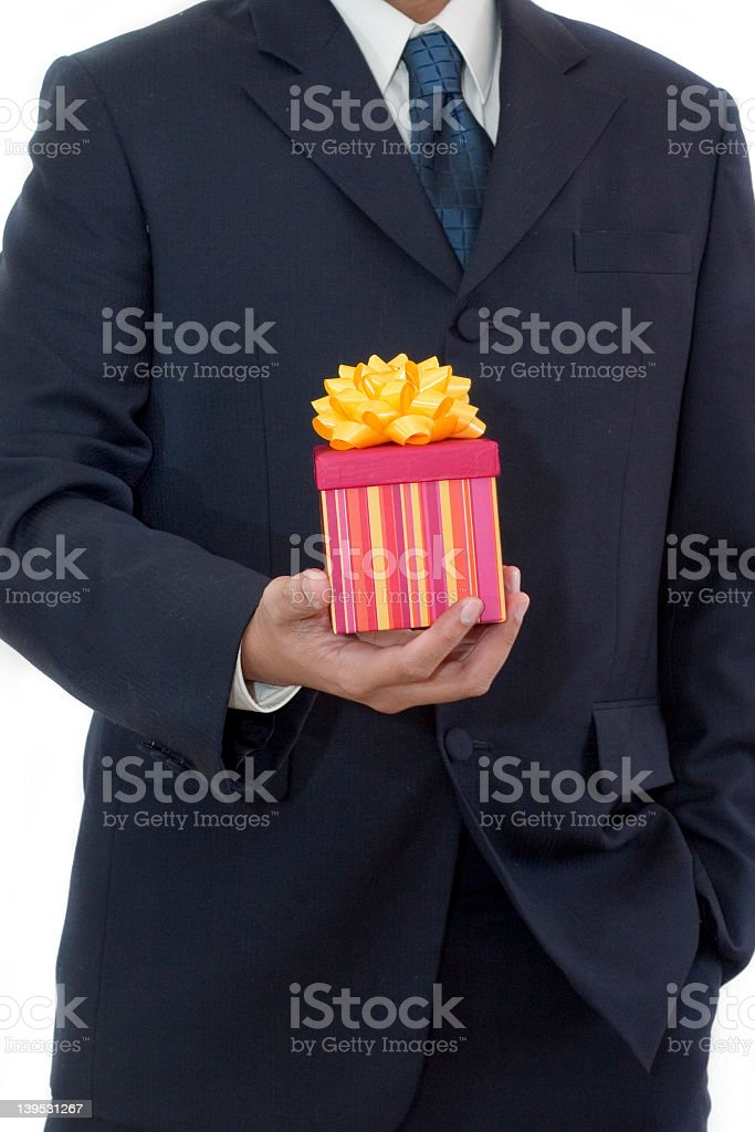 Businessman Holding a Gift royalty-free stock photo