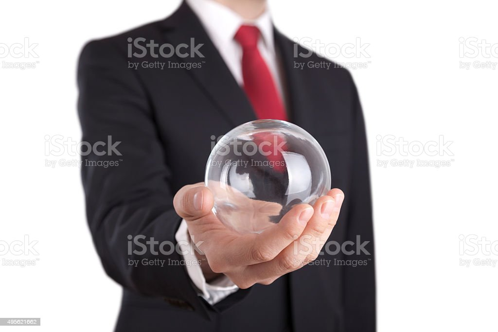 Businessman holding a glass ball isolated on white stock photo