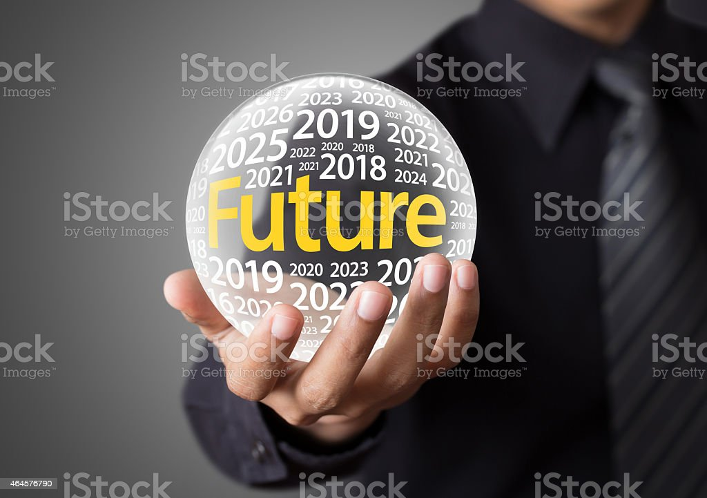 Businessman holding a glass ball stock photo