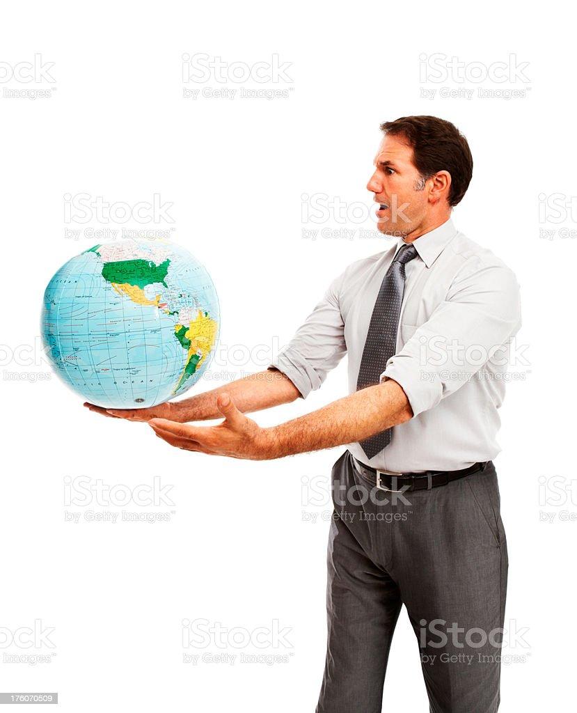 Businessman holding a globe royalty-free stock photo
