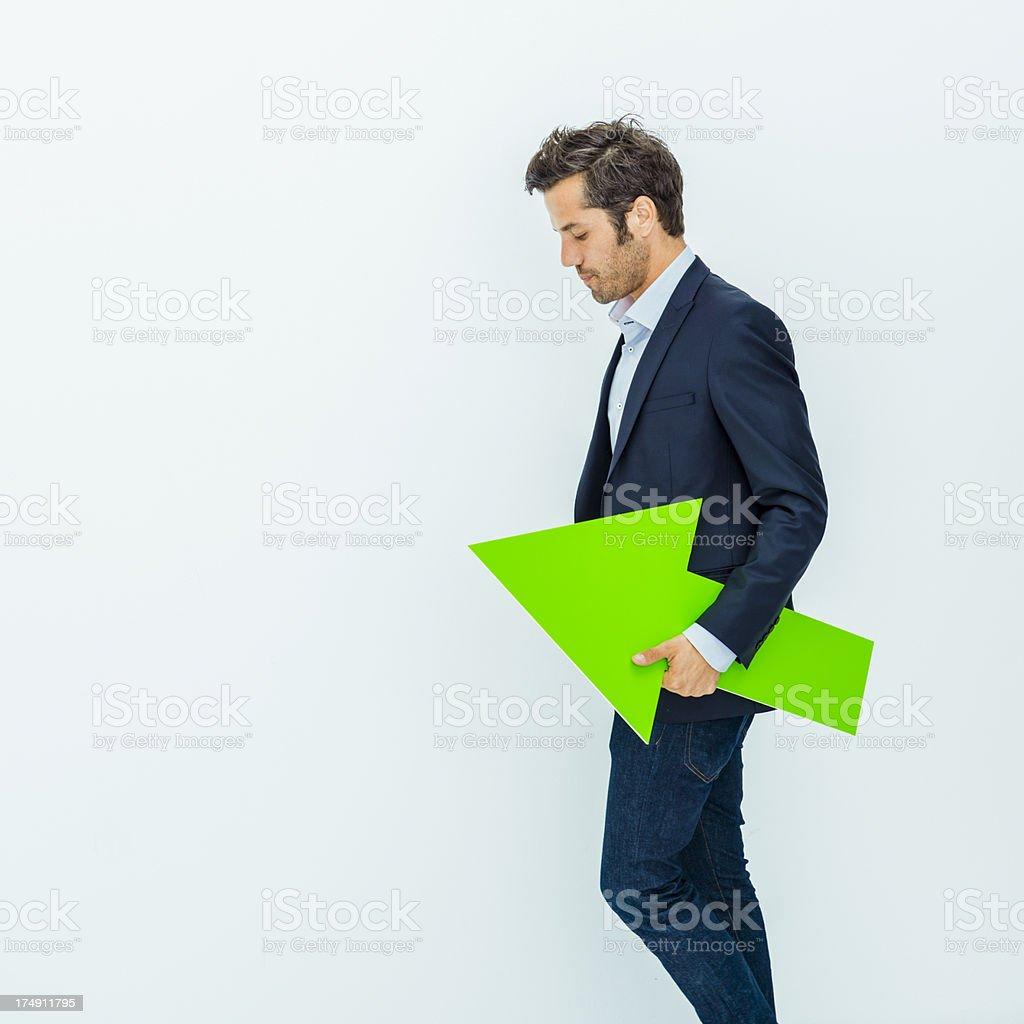 Businessman holding a green arrow stock photo