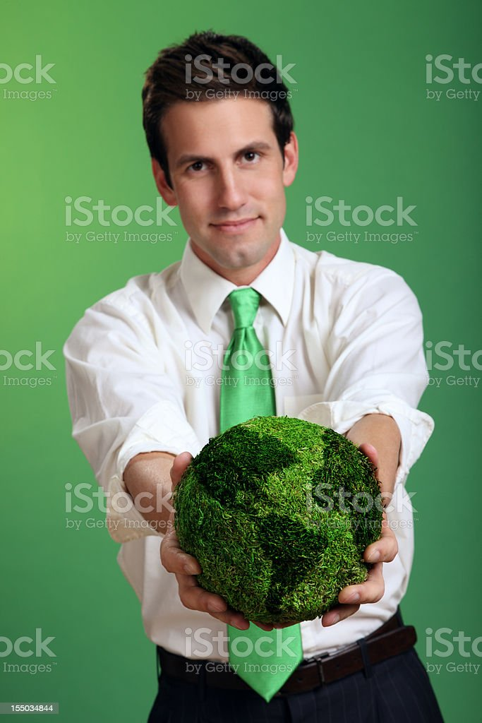 Businessman Holding a Green Earth royalty-free stock photo