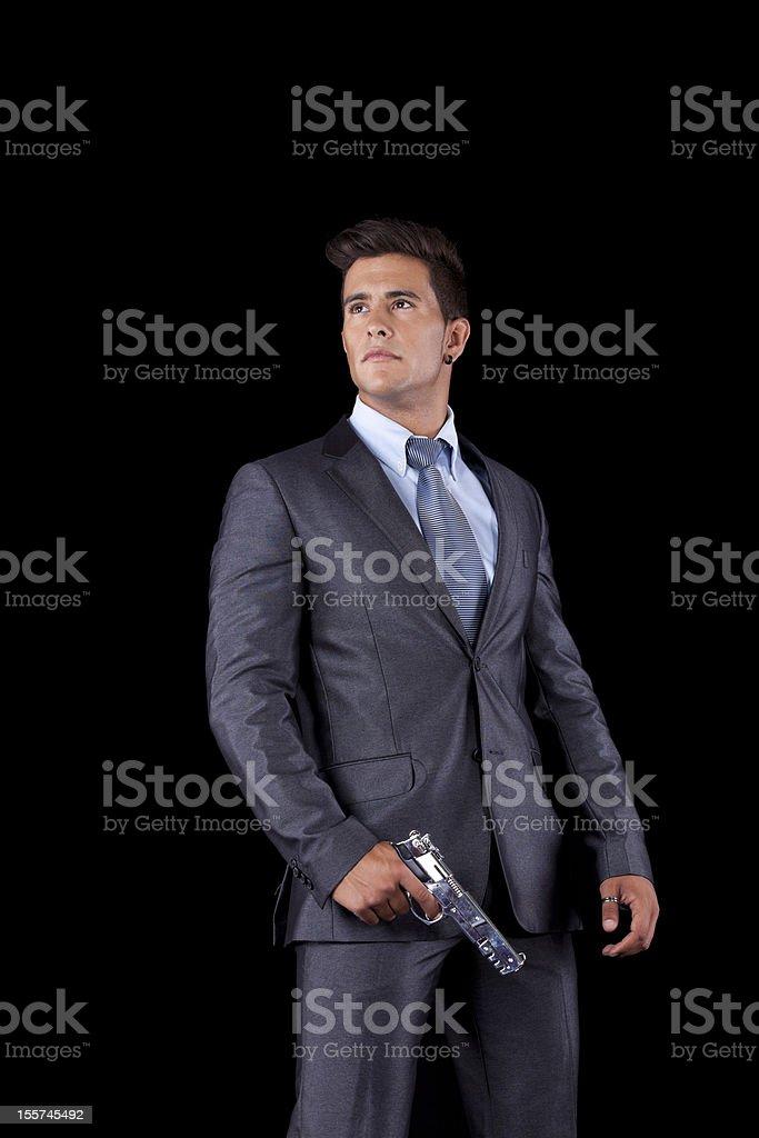 Businessman holding a handgun royalty-free stock photo