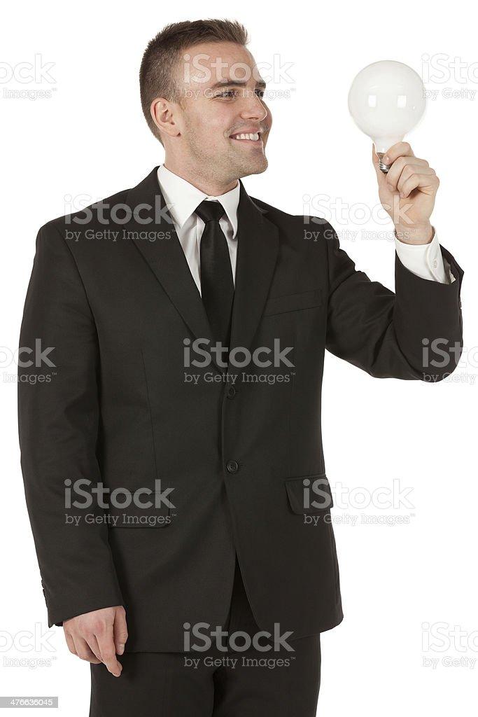 Businessman holding a light bulb royalty-free stock photo