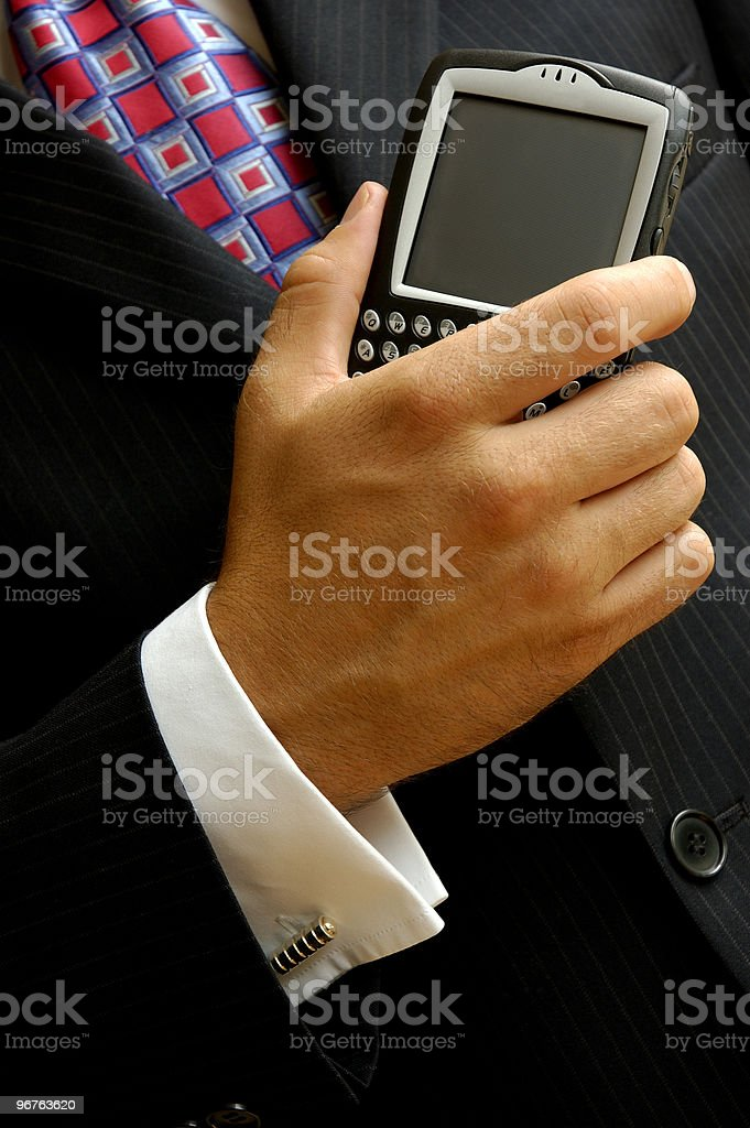 Businessman Holding  a PDA stock photo