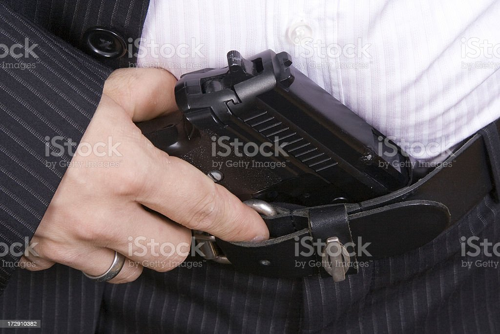 Businessman holding a pistol royalty-free stock photo