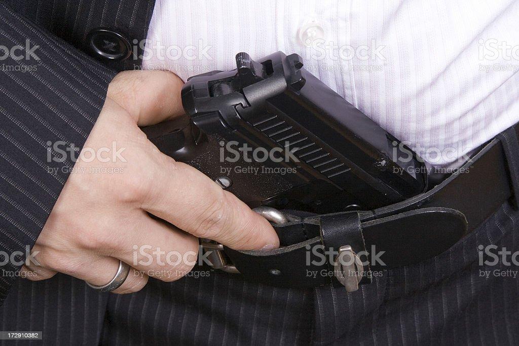 Businessman holding a pistol stock photo