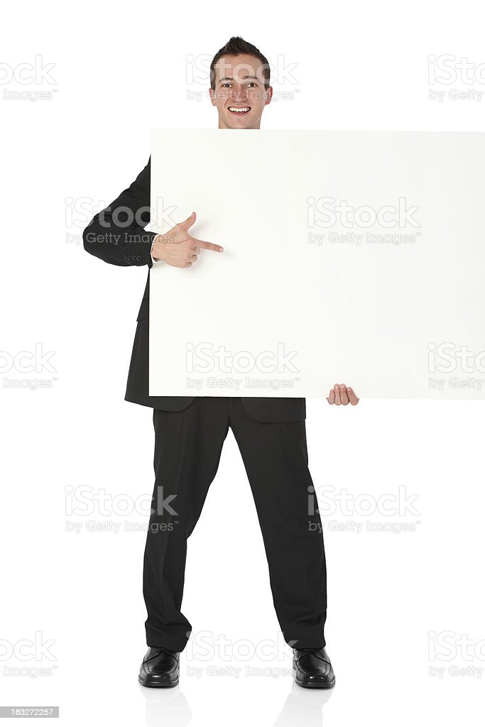Businessman holding a placard royalty-free stock photo