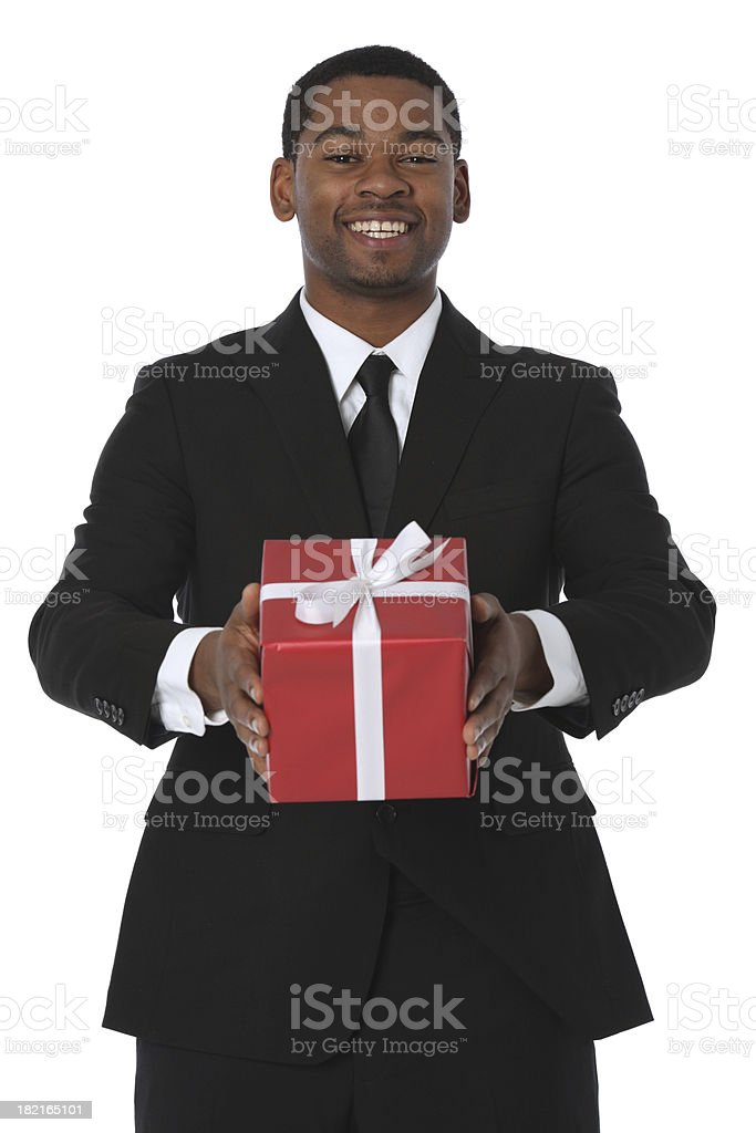 Businessman holding a present stock photo