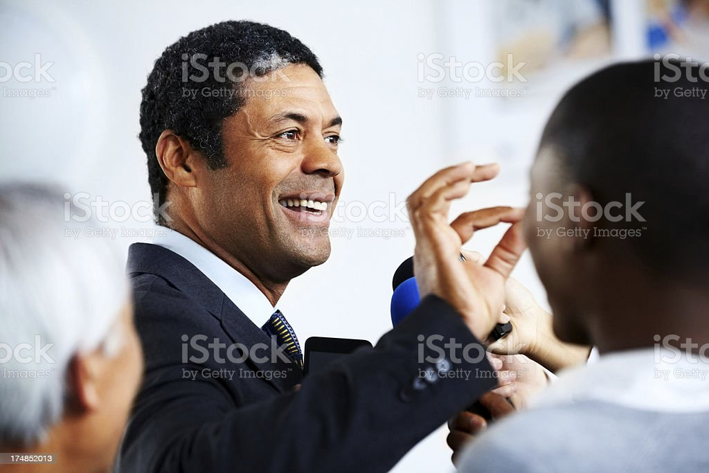 Businessman holding a press conference stock photo