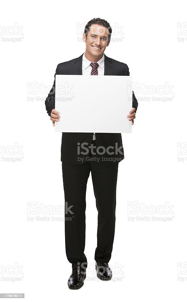 Businessman holding a sign full body stock photo