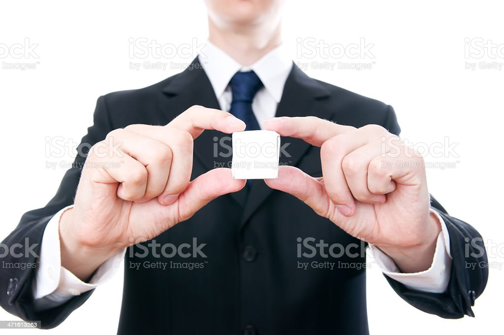 Businessman holding a small cube royalty-free stock photo
