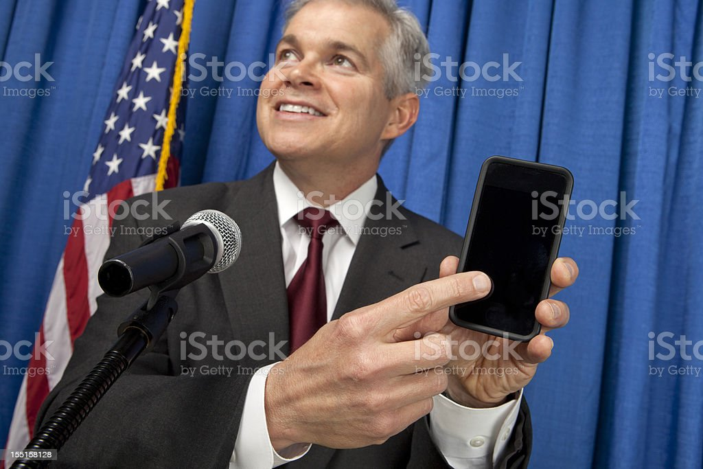 Businessman Holding A Smart Phone royalty-free stock photo