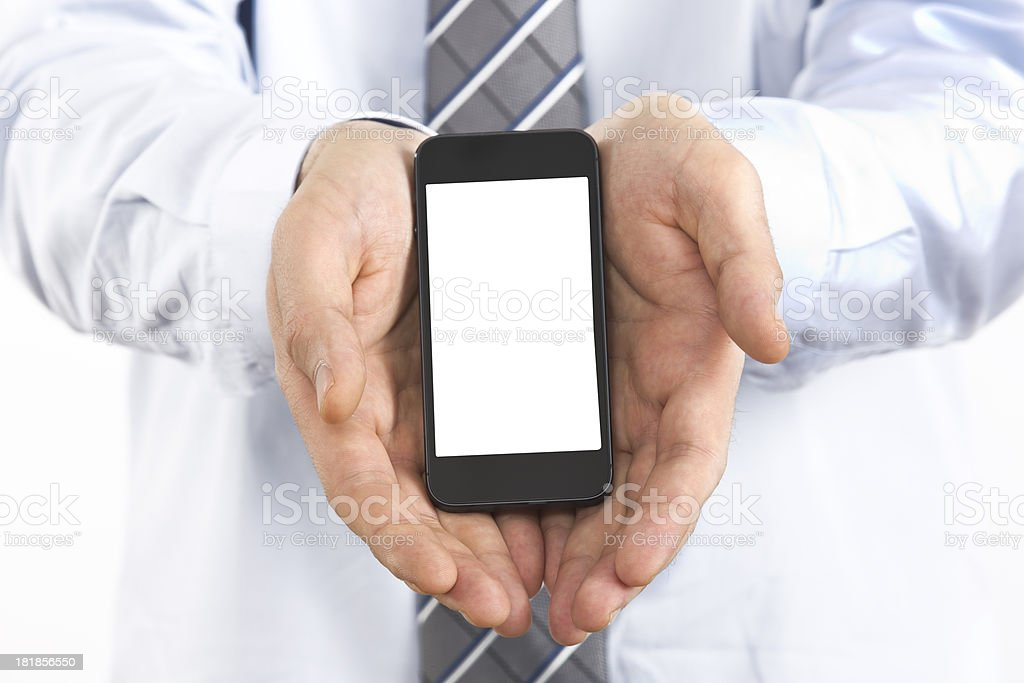 businessman holding a smartphone royalty-free stock photo