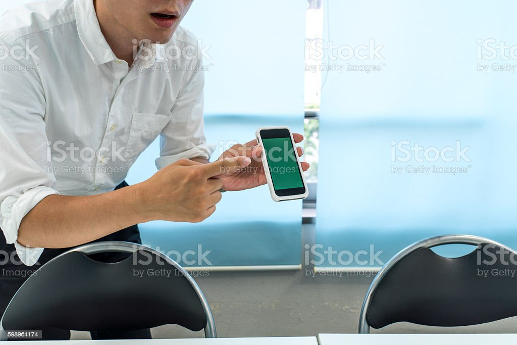 Businessman holding a smartphone stock photo