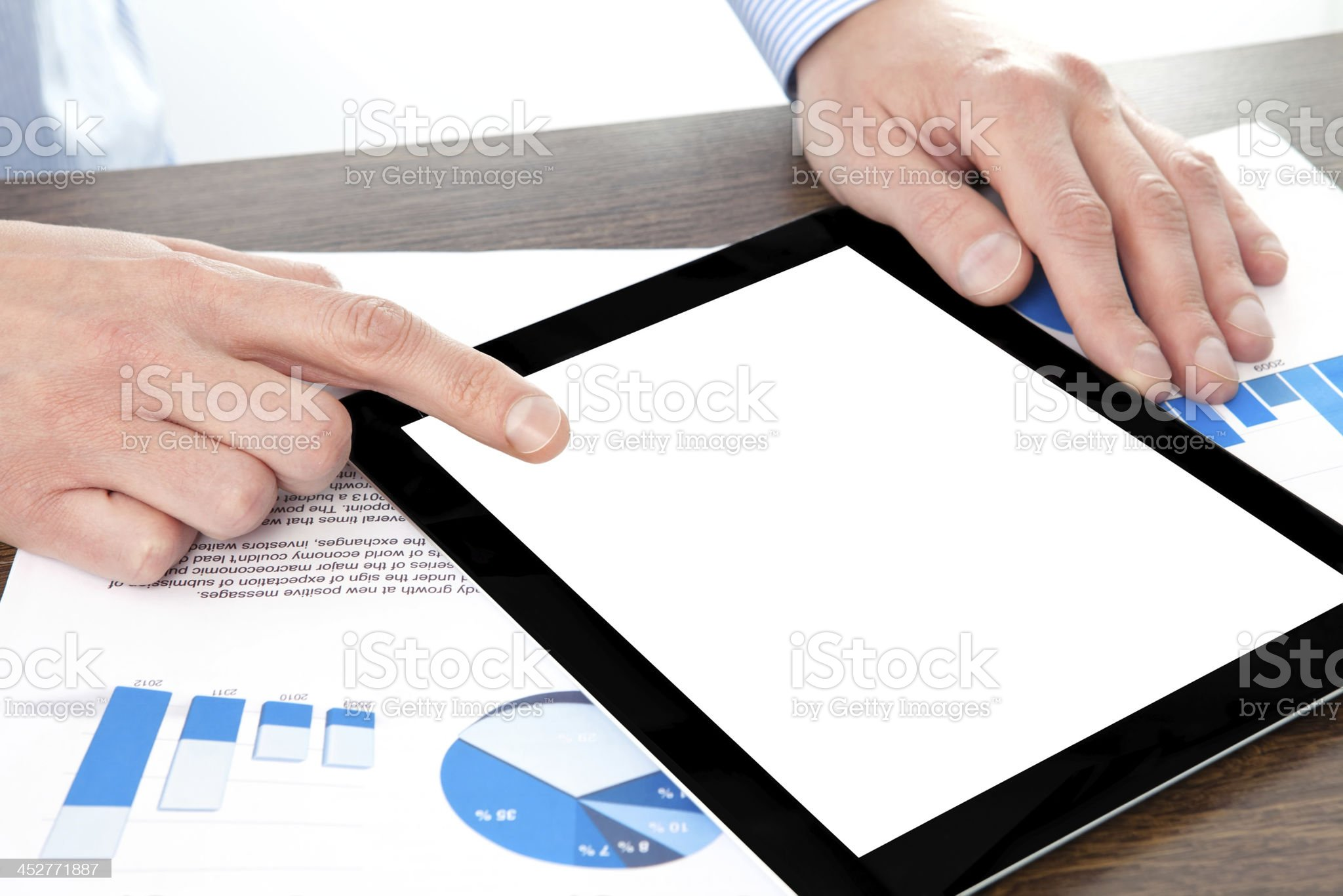 businessman holding a tablet computer on the table with graphics royalty-free stock photo