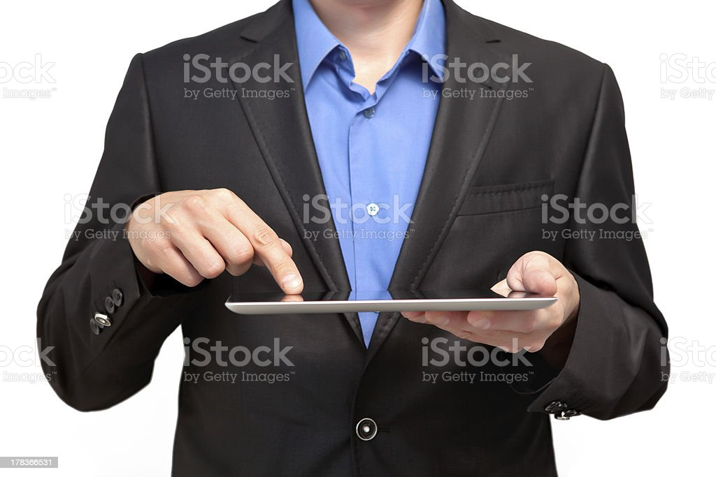 Businessman holding a tablet royalty-free stock photo