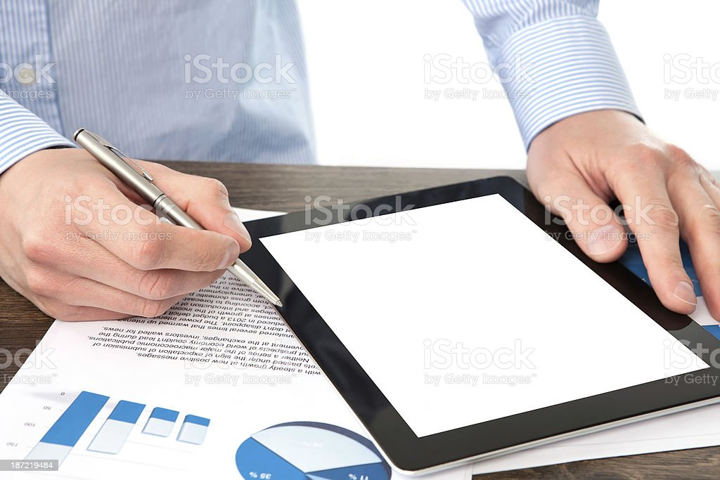 businessman holding a tablet with isolated screen royalty-free stock photo