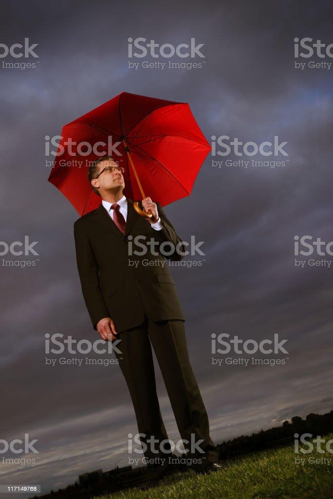 Businessman Holding a Umbrella royalty-free stock photo