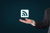 Businessman holding a virtual WiFi symbol