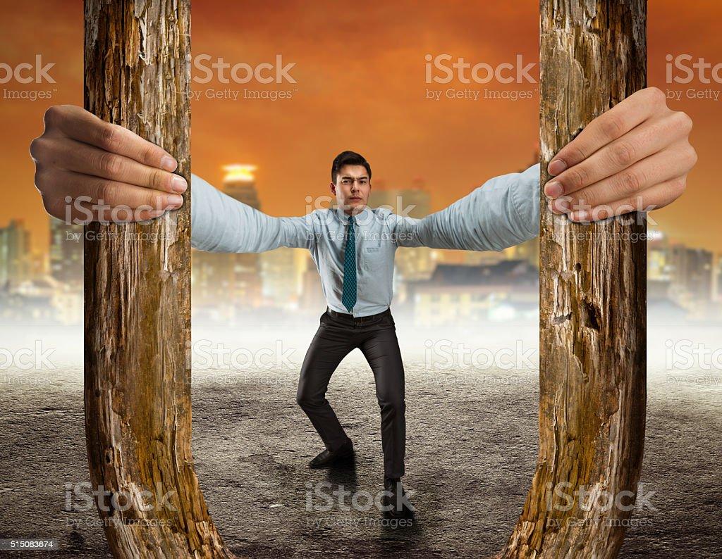 Businessman holding a wooden horseshoe stock photo