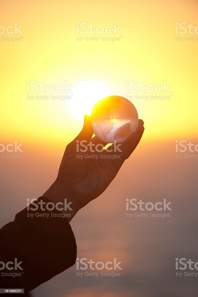 Businessman holding a world globe at dawn royalty-free stock photo