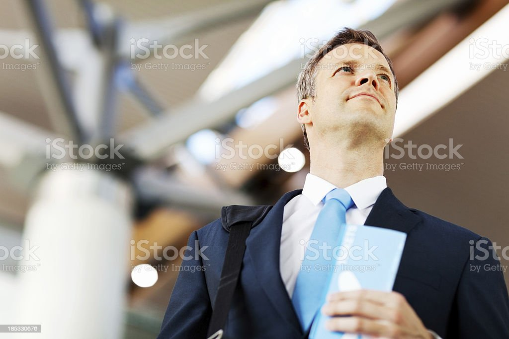 Businessman Holding Airline Tickets At Airport royalty-free stock photo