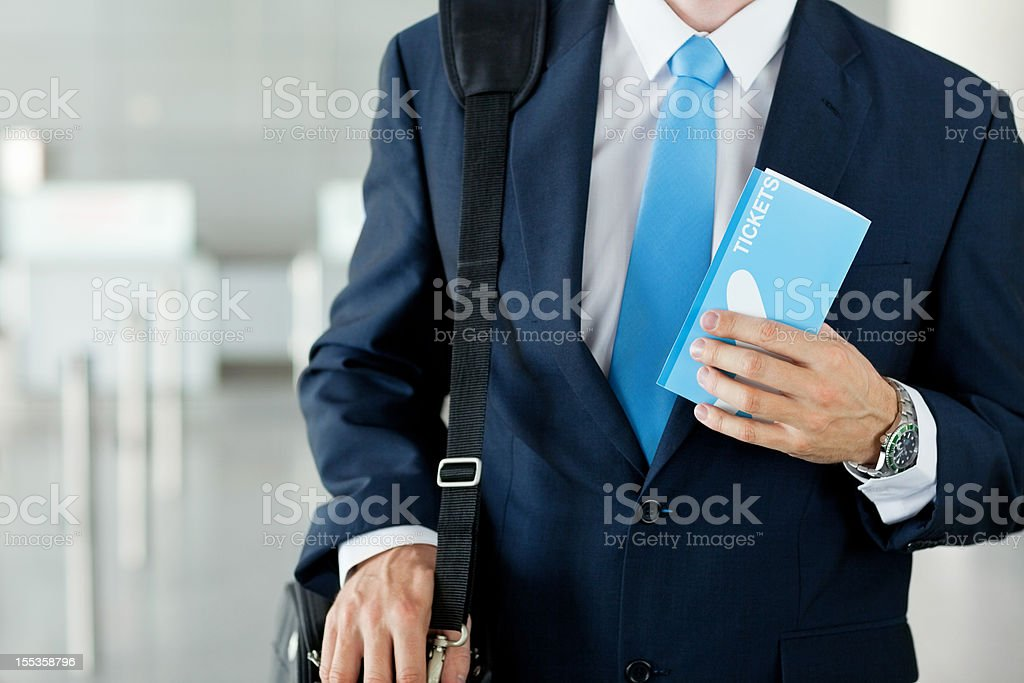 Businessman Holding Airplane Ticket At Airport royalty-free stock photo