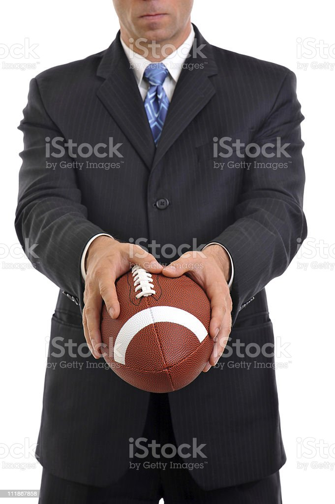 Businessman Holding American Football Isolated on White Background stock photo