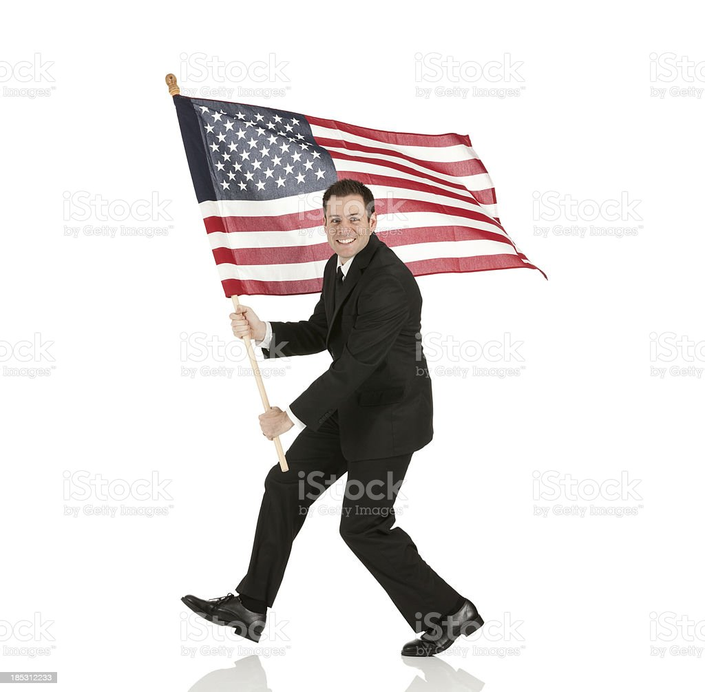 Businessman holding an American flag stock photo