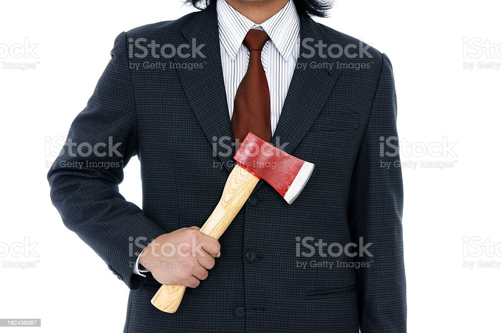 Businessman holding an axe royalty-free stock photo