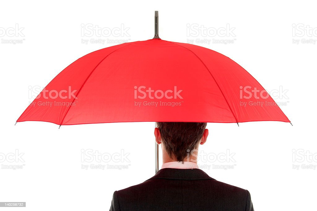 Businessman holding an umbrella royalty-free stock photo
