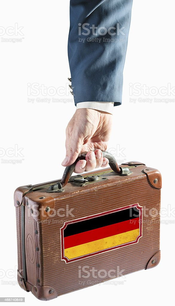 Businessman holding antique suitcase Germany flag royalty-free stock photo