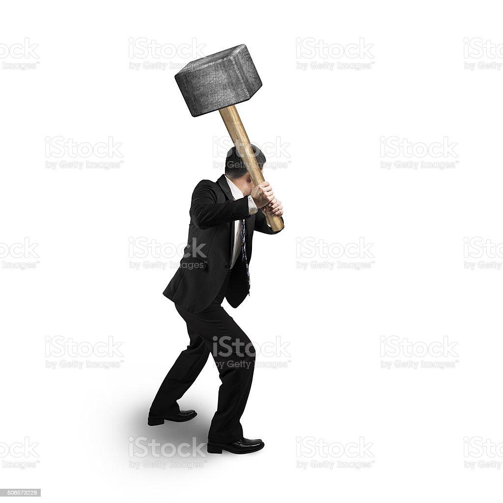 Businessman holding big hammer stock photo
