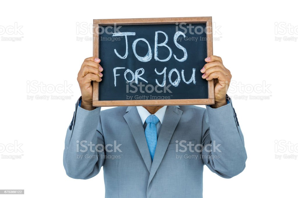 Businessman holding black board stock photo
