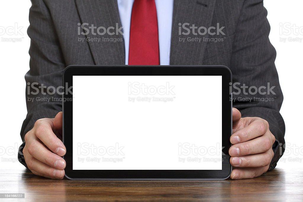 Businessman holding blank digital tablet stock photo