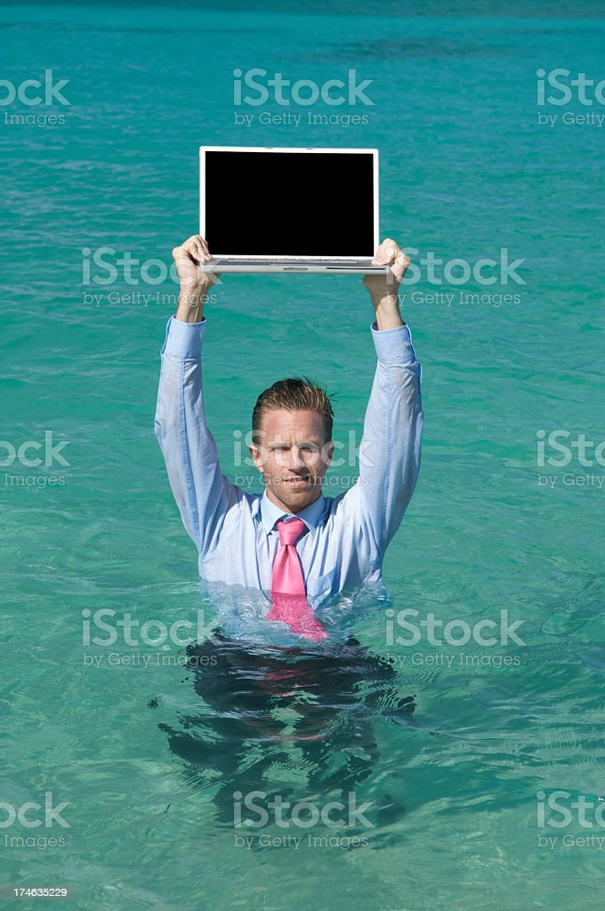Businessman Holding Blank Laptop Over Head in Deep Water Message royalty-free stock photo