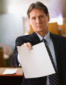 Businessman holding blank paper
