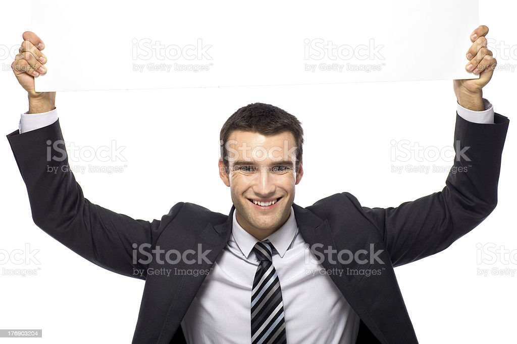 Businessman holding blank sign above his head royalty-free stock photo