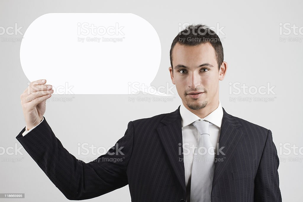 Businessman holding blank speech bubble waiting for success stock photo