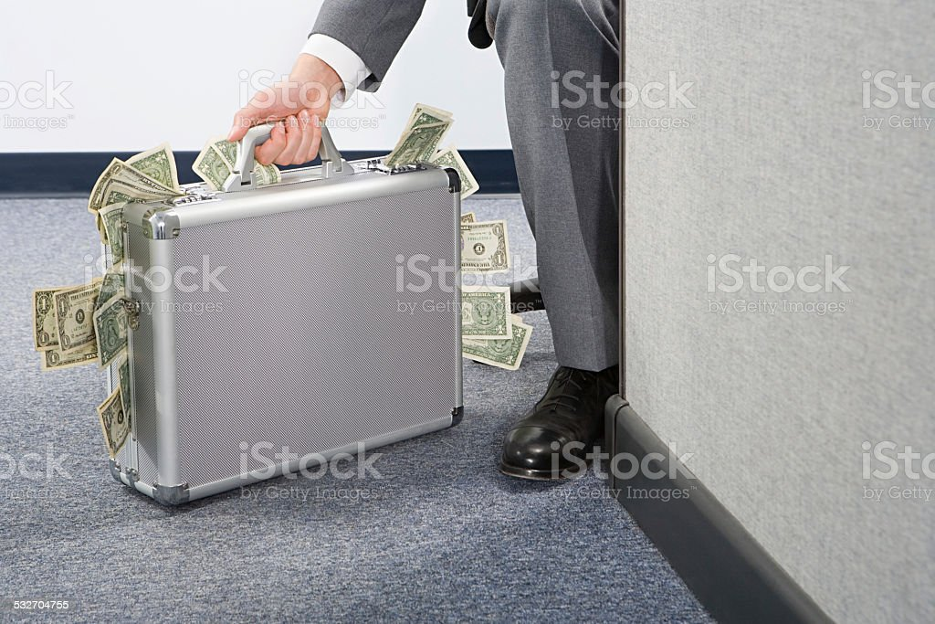 Businessman holding briefcase stock photo