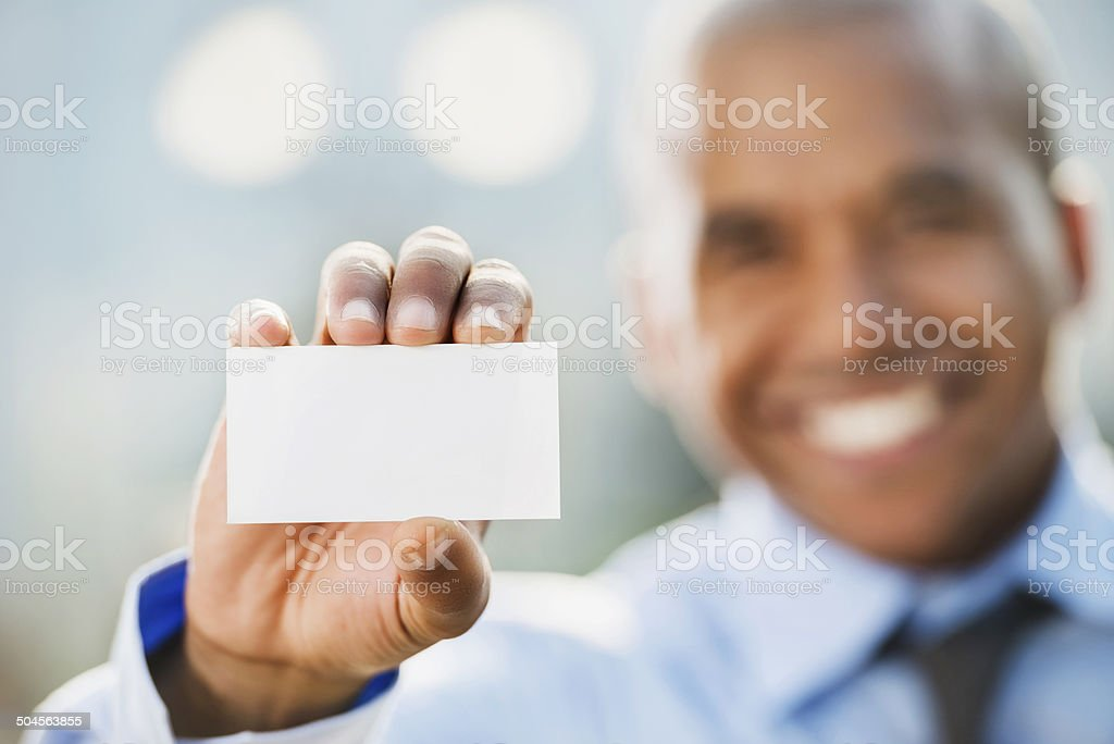 Businessman holding business card. stock photo