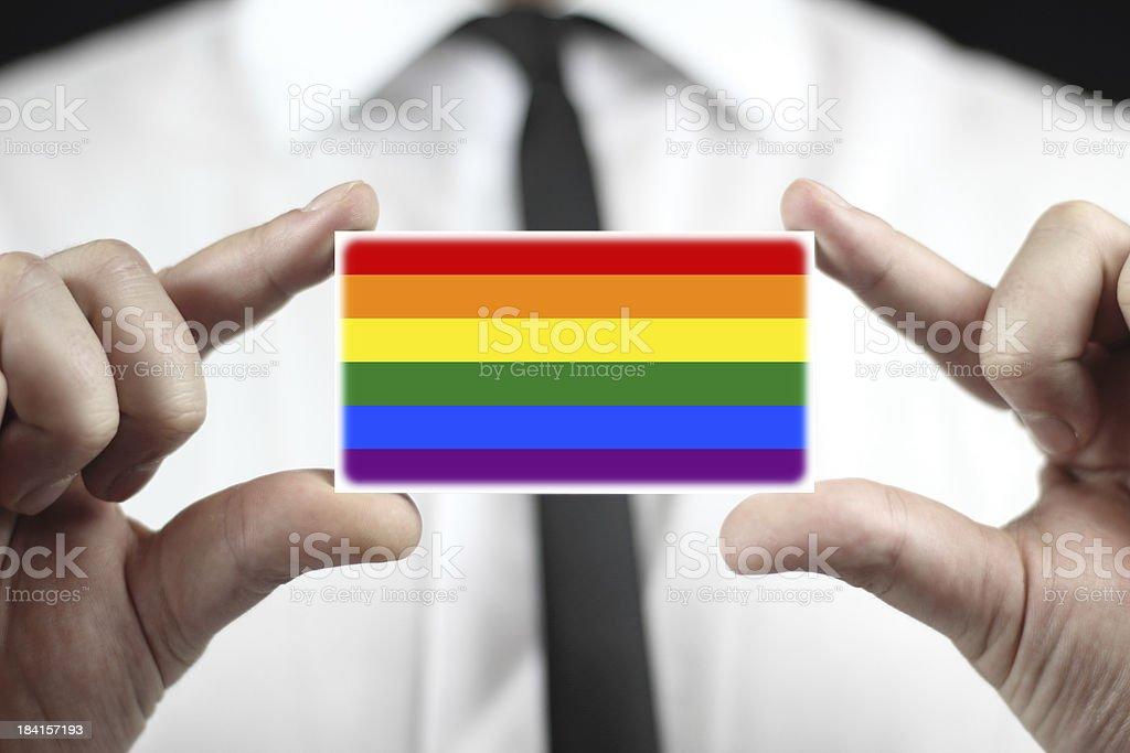 Businessman holding business card with a Rainbow Flag stock photo