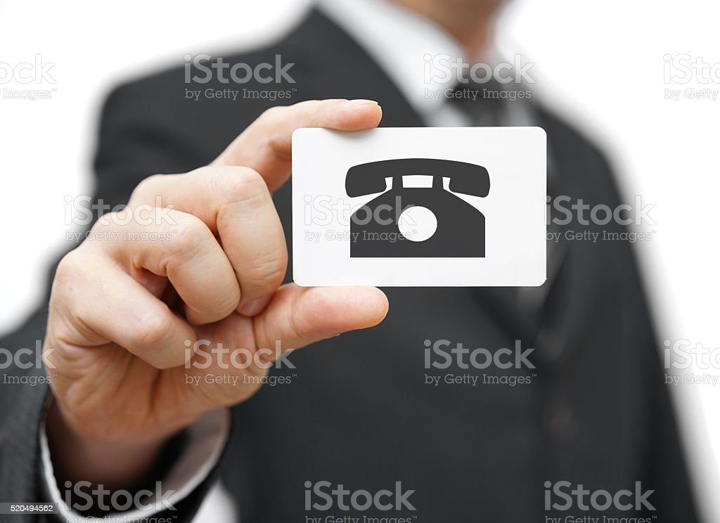 businessman holding business card with telephone icon, call us concept stock photo