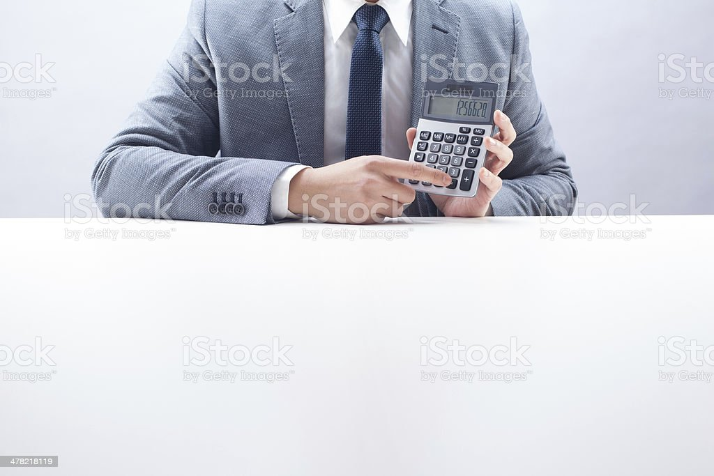 Businessman Holding Calculator royalty-free stock photo