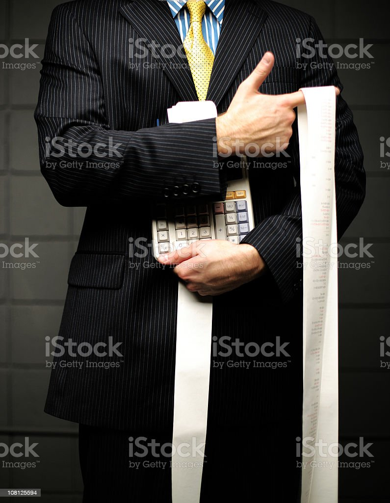 Businessman Holding Calculator with Long Paper Roll stock photo
