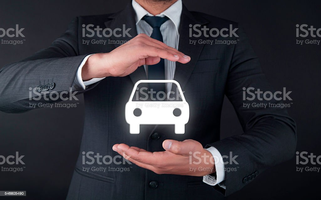 Businessman holding car stock photo